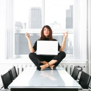 woman meditate on desk - square